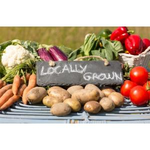 Farmers+Market+vegetables+with+a+sign+stating+-locally+grown-.jfif
